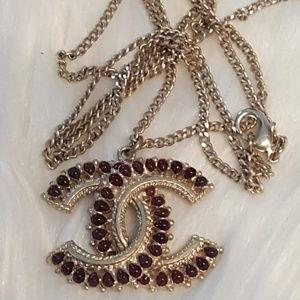 Chanel gold CC burgundy stones pendant necklace